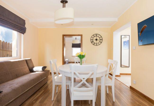 room, table, chairs, sofa, door, window, TV